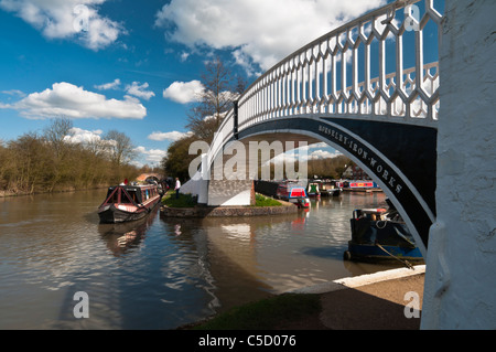 Narrowboat being moored on the Grand Union Canal beside the ornate arched bridge at Braunston Marina, Northamptonshire, - Stock Photo