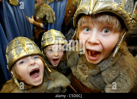 Young Vikings at the Up Helly Aa Fire Festival Shetland Islands - Stock Photo
