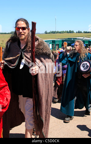 Male Pagan druids leaves Stonehenge after celebrating the Summer Solstice Pagan Festival - Stock Photo