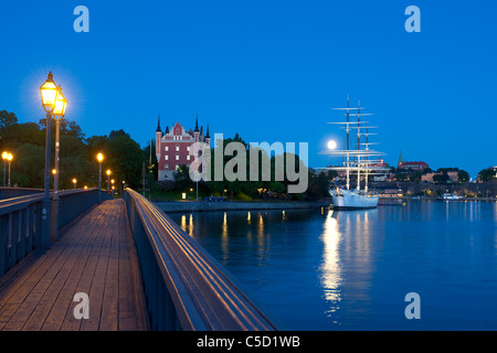 Narrow footbridge by Al Chapman in peaceful lake at night, Stockholm, Sweden - Stock Photo