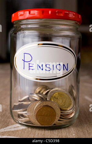 Close-up of pension funds in a glass jar - Stock Photo
