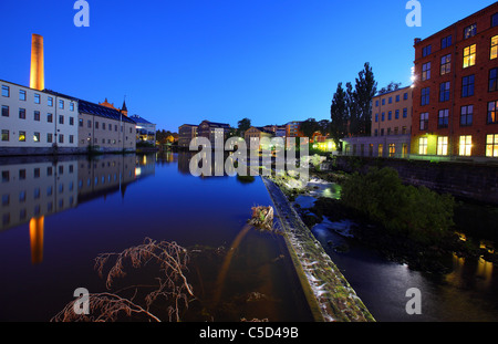 View of industrial landscape in Norrkoping against blue sky at Sweden - Stock Photo