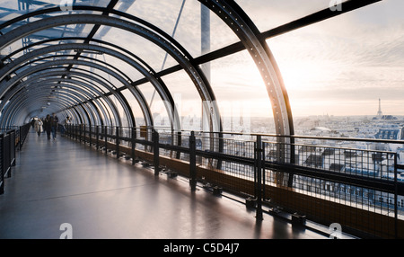 View of sunset over Paris city from an arched walkway in France - Stock Photo