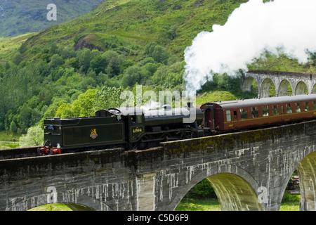 Steam train on Glenfinnan Viaduct, Highland, Scotland,UK - Stock Photo