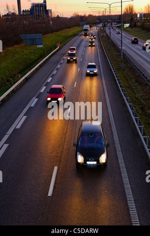High angle view of cars on asphalt country roads in the evening - Stock Photo