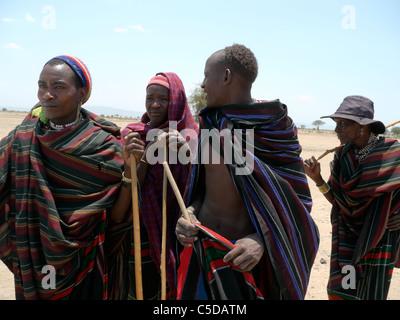 TANZANIA Watatulu tribesmen of Miyuguyu, Shinyanga district. Group of men wearing traditional clothes and beads. - Stock Photo