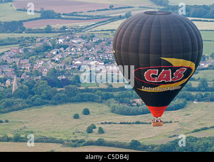 Hot Air Balloon in flight over Northamptonshire - Stock Photo