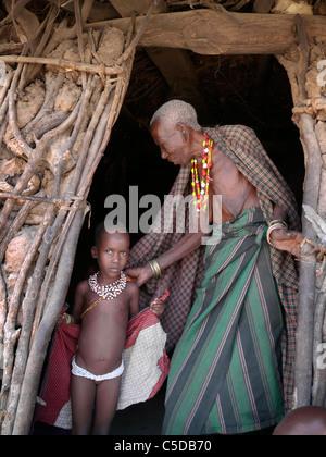 TANZANIA Watatulu tribesmen of Miyuguyu, Shinyanga district. Grandmother and child in doorway of house - Stock Photo