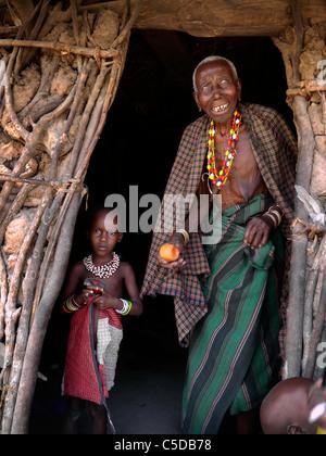 TANZANIA Watatulu tribesmen of Miyuguyu, Shinyanga district. Grandmother and child in doorway of house. - Stock Photo