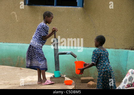 TANZANIA Home of Compassion, for the sick and needy, Kigera village, near Musoma. Girls collecting water from hand - Stock Photo