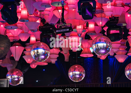 Pink disco ball stock photo 279853527 alamy spinning disco balls and lots of pink lights hang from the ceiling of a nightclub on aloadofball Choice Image