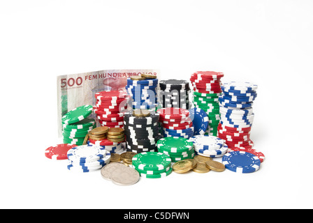 Close-up of Swedish currency and casino chips against white background