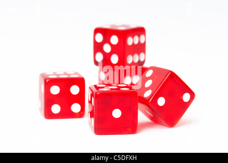 Close-up of red dices against white background - Stock Photo