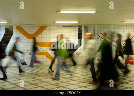 Blurred people walking in the underground subway in Stockholm, Sweden - Stock Photo