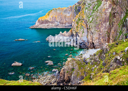 Rocky coastline and cliffs at Baggy Point a headland near Croyde, North Devon, England, UK - Stock Photo