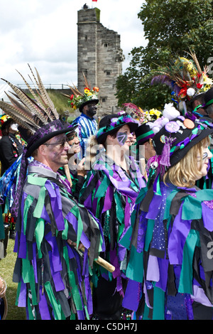 Exmoor Border Morris Dancers, black-faced, wearing long flowing torn old rags, clothing made from wide bolts of - Stock Photo
