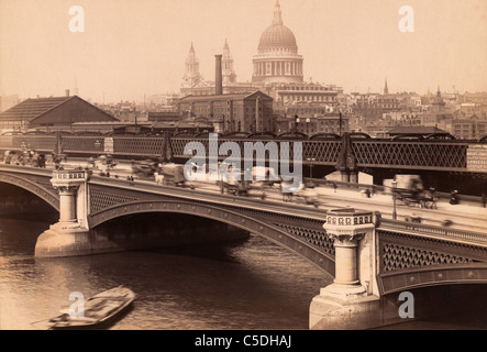 London, England. Blackfriar's Bridge with St. Paul's cathedral behind. - Stock Photo