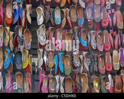 Traditional leather Shoes on display outside a shop. Pune, Maharashtra, India - Stock Photo