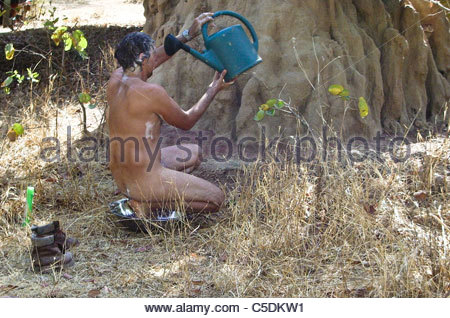 Camping equipment used by explorer Kypros in Africa - Watering can shower again ... Burkina Faso - Stock Photo