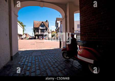 View of Market Place through covered alley of the picturesque town of Faversham in Kent - Stock Photo