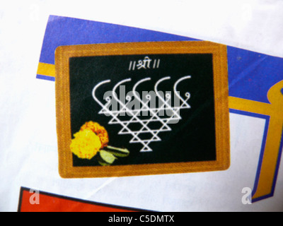 Graphic of sarasvati, goddess of speech and eloquence drawing on a slate, India - Stock Photo