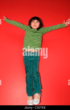 Young girl jumping - Stock Photo
