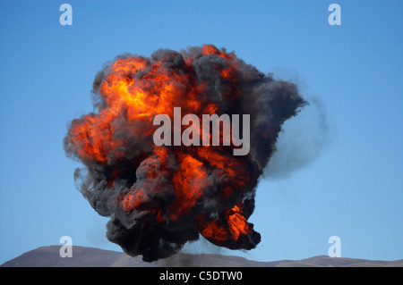 Controlled Explosions at Warbirds Over Wanaka Airshow, Otago, South Island, New Zealand - Stock Photo