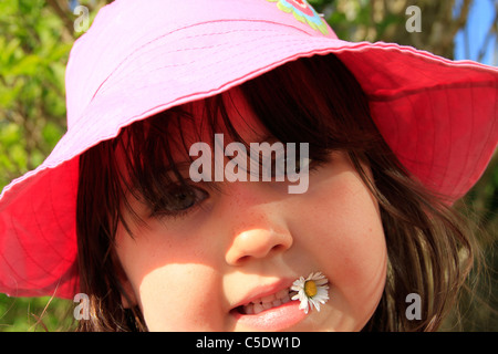Girl with daisy - Stock Photo