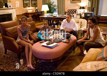 President Barack Obama and his daughters Sasha and Malia watch the World Cup soccer game between the U.S. and Japan - Stock Photo