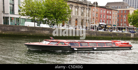 The Spirit of Docklands, a sightseeing boat run by Liffey River Cruises, on the River Liffey in central Dublin. - Stock Photo