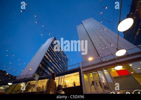 Low angle view of skyscrapers with hanging lights against blue sky in Stockholm, Sweden - Stock Photo
