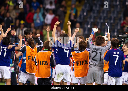Japan team group celebrates after winning the FIFA Women's World Cup Germany 2011 Semi-final match between Japan - Stock Photo