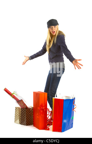 Shocked young woman with shopping bags against white background - Stock Photo