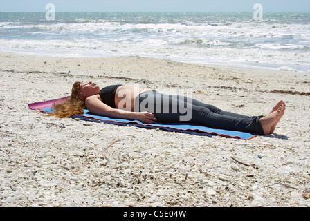 woman doing savasana corpse pose stock photo 34632761