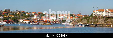 Panoramic shot of lake with houses against clear sky in the background - Stock Photo