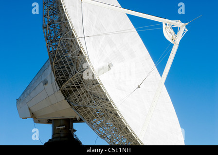 Low angle close-up view parabolic antenna against clear blue sky - Stock Photo