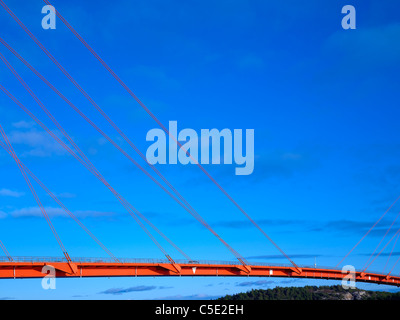 Close-up of wires on suspension bridge against the blue sky - Stock Photo
