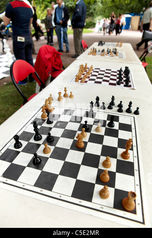 Close-up of chess boards in a row on the outdoor table - Stock Photo