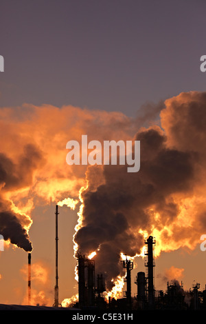Smokes emitting from chimneys at the industry area - Stock Photo