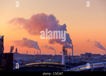 High angle view of Gothenburg city with chimneys emitting smoke in the background - Stock Photo