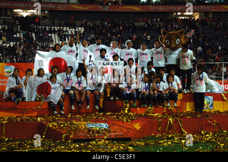 Japan team celebrates with the trophy after winning the FIFA Women's World Cup  2011 Final match, Japan 2(3 PK 1)2 - Stock Photo