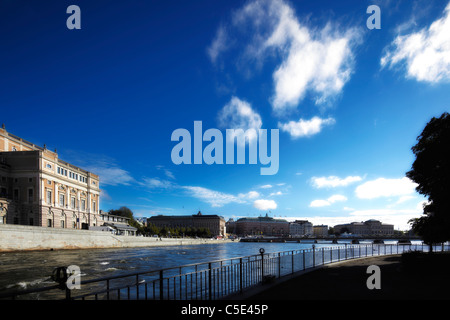Opera house and buildings against blue sky and clouds with lake in foreground at Stockholm, Sweden - Stock Photo