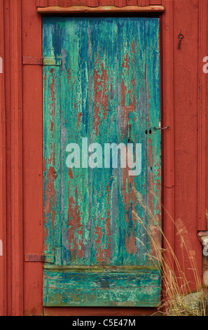 Close-up of a closed old wooden door - Stock Photo