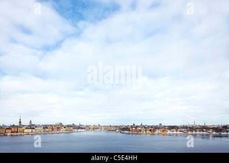 Stockholm city against the cloudy sky with Baltic sea in foreground - Stock Photo