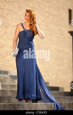 Full length portrait of a teenage girl in ball gown - Stock Photo