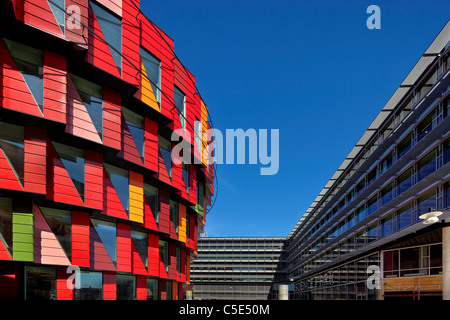 High section of colorful and office buildings against clear blue sky at Lindholmen, Stockholm - Stock Photo