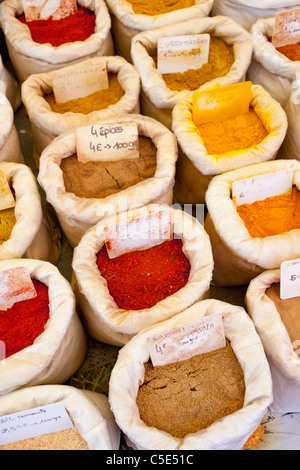 Spices for sale in street market stall, France. - Stock Photo