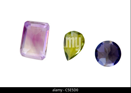 Three semi-precious gemstones Amethyst from Brazil, Green Peridot from Ethiopia and Blue Iolite from India - Stock Photo