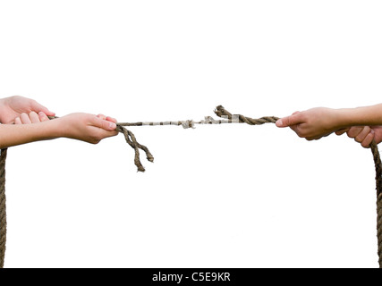 Close-up of hands playing the tug of war against white background - Stock Photo