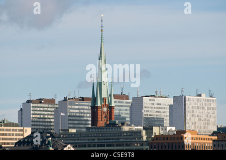 High section of church steeple and buildings against the sky in Stockholm, Sweden - Stock Photo